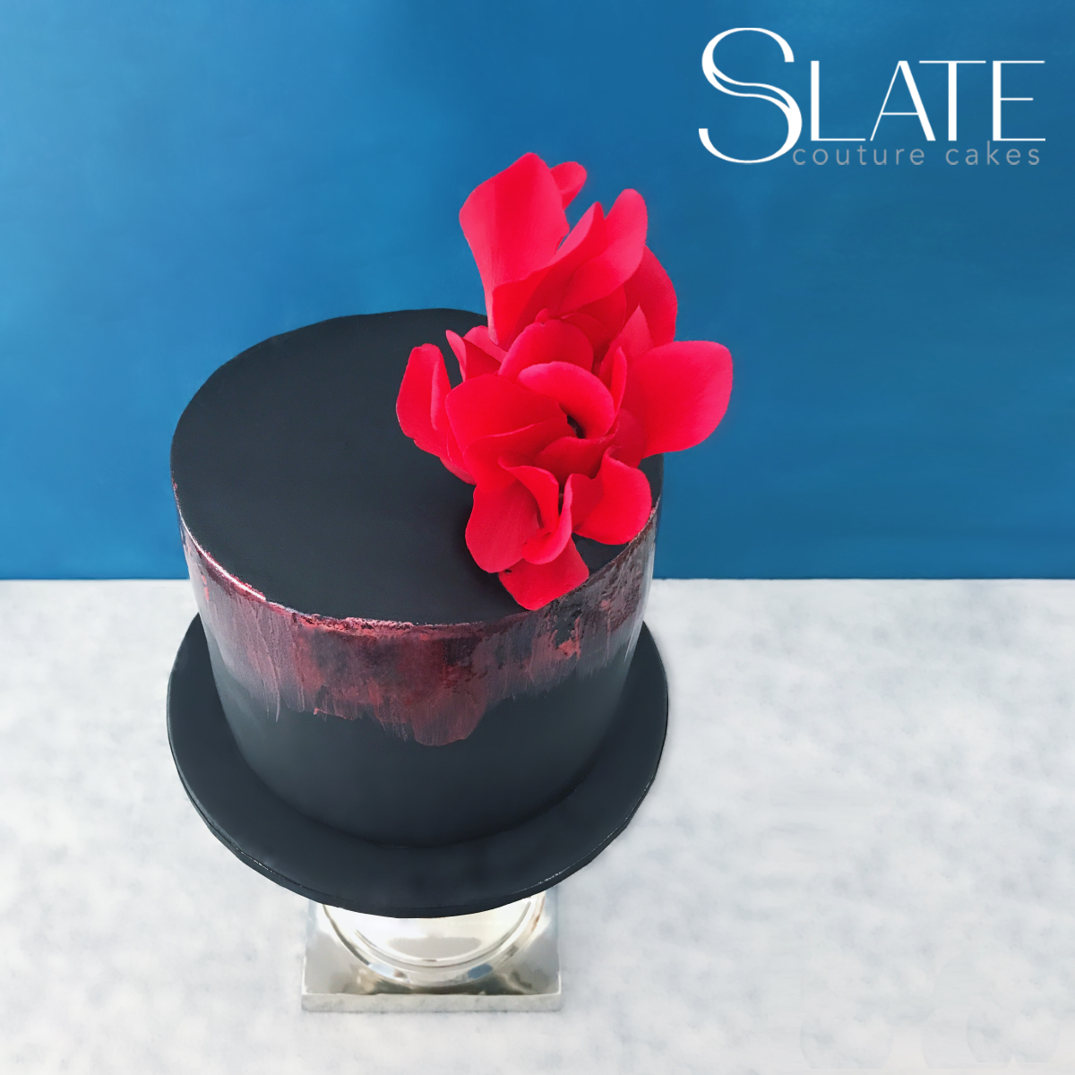 Black mini wedding cake with red sugar flower