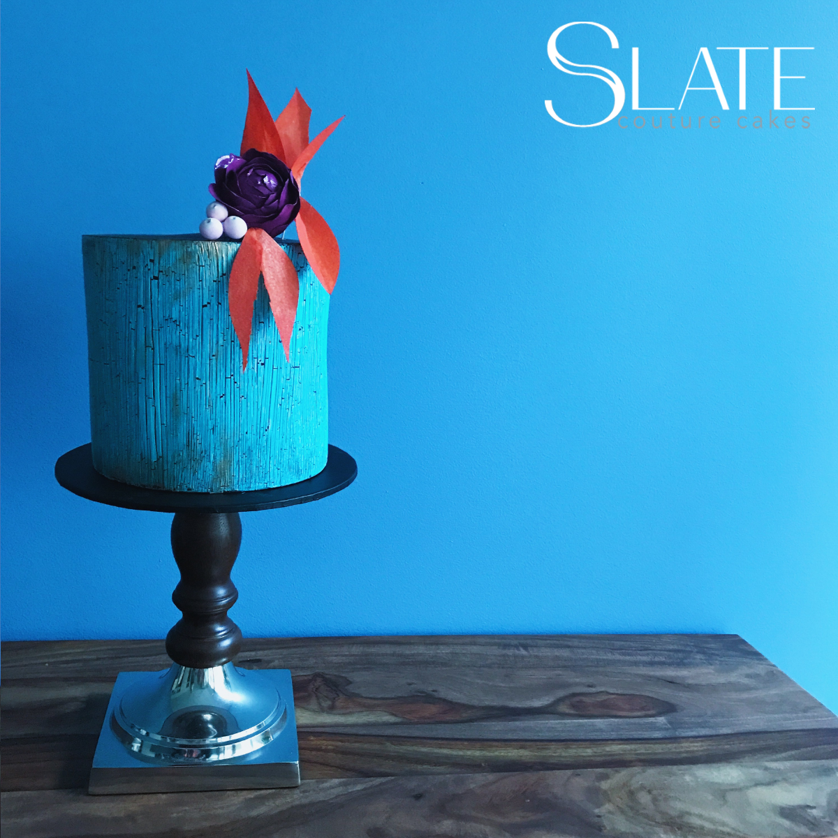 Blue bark mini cake with purple sugar flower