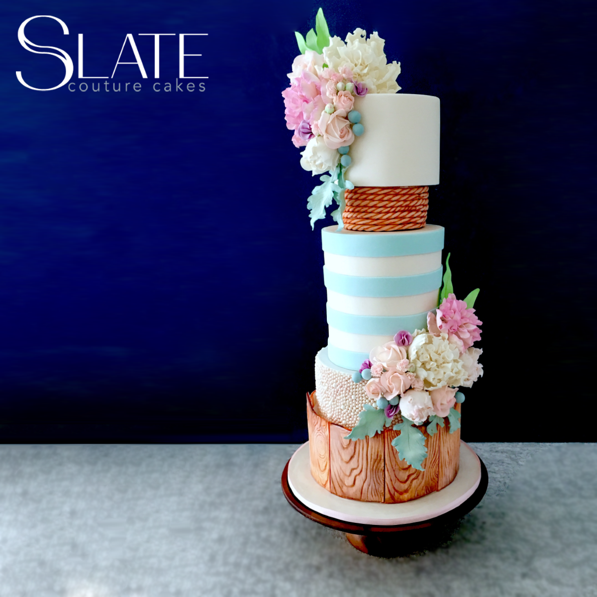 Light blue and white striped nautical themed wedding cake