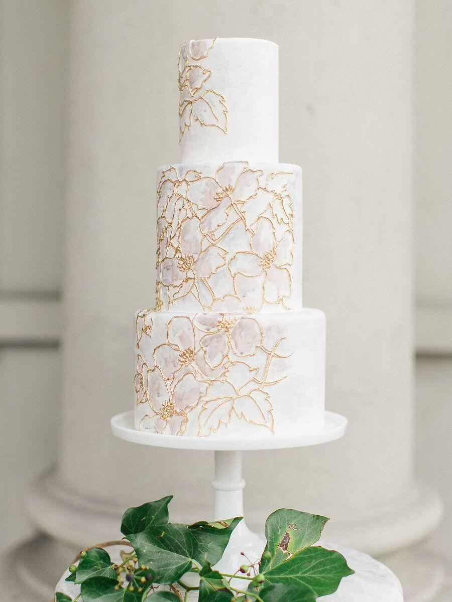 White wedding with gold stenciled flowers