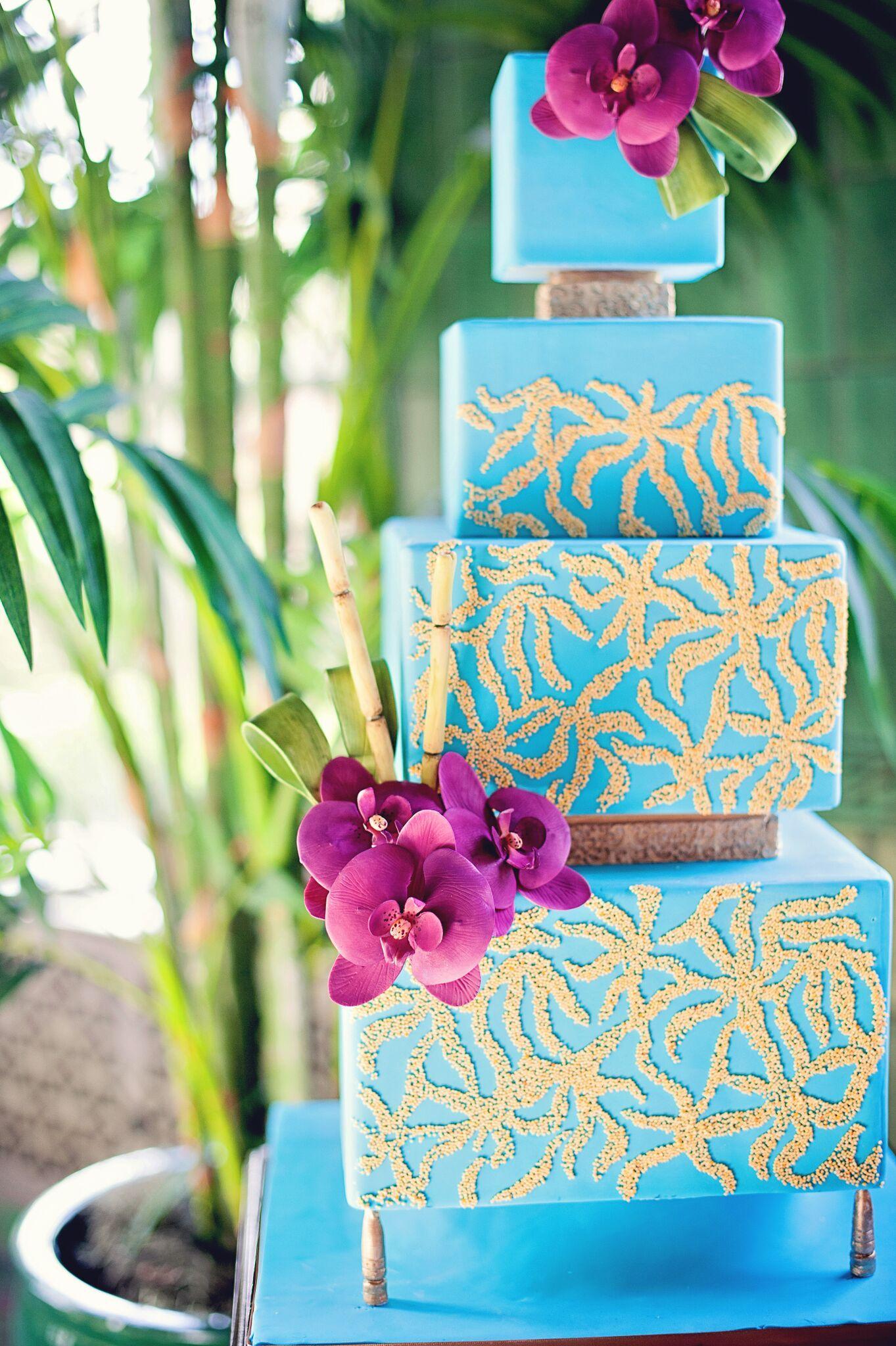 Bright blue tropical wedding cake