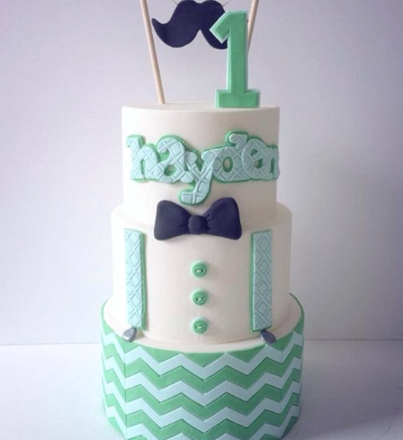 Turquoise and white bowtie themed cake