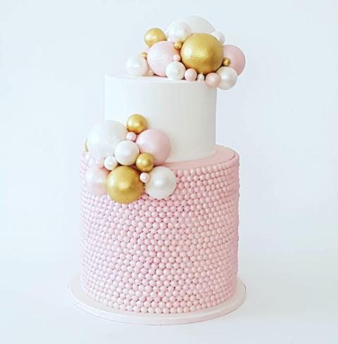 Pink and white sugar pearl birthday girl cake