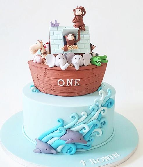 Fondant safari animals in arc first birthday cake