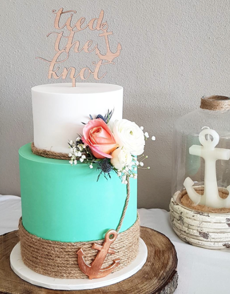 Turquoise and white nautical themed wedding cake