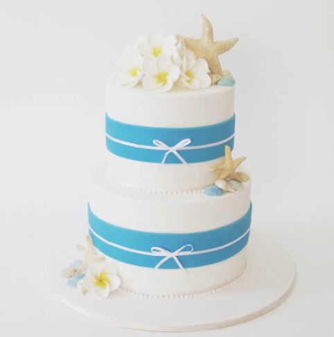 Blue and white beach themed wedding cake