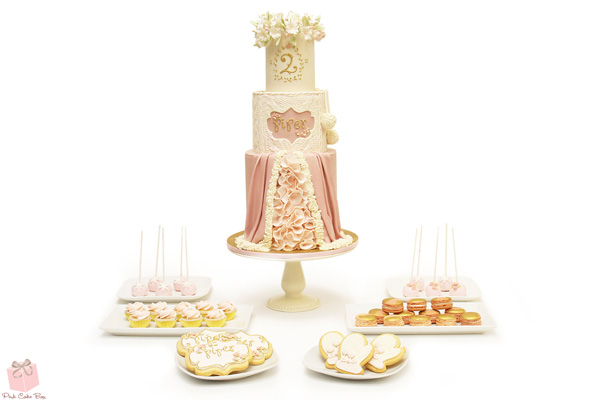 Light pink and creme colored Marie Antoinette themed fondant birthday girl cake