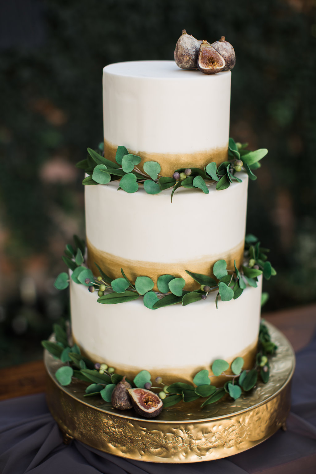 White fall wedding cake with greenery
