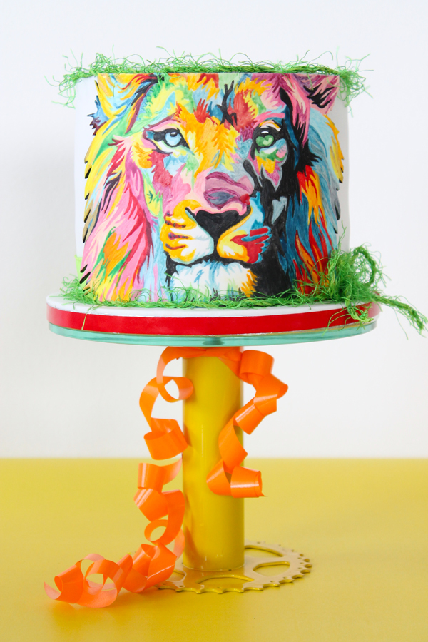Handpainted rainbow lion cake