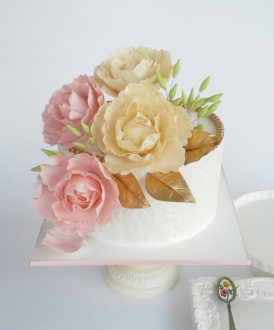 Mini white wedding cake with sugar flowers