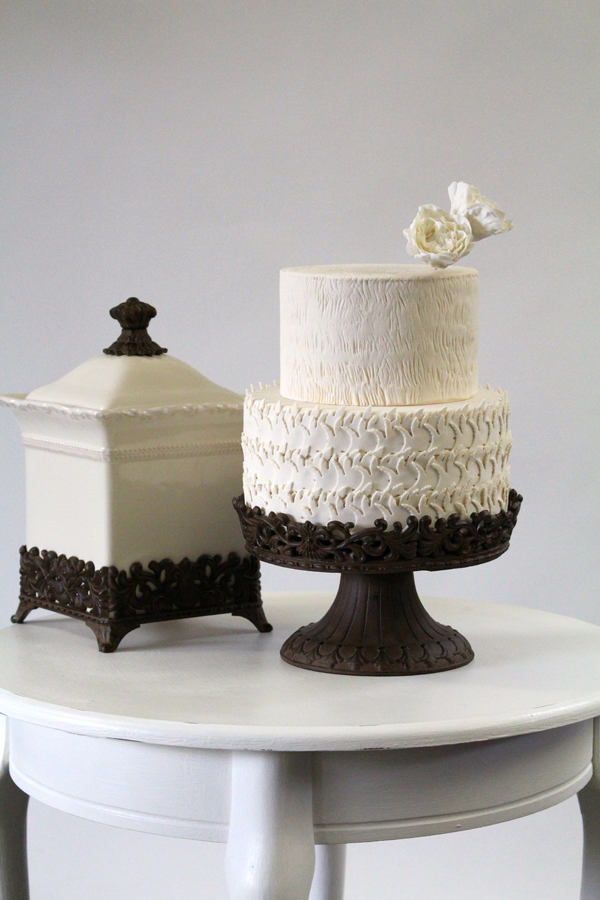 Ivory fondant two tiered wedding cake with white sugar flower