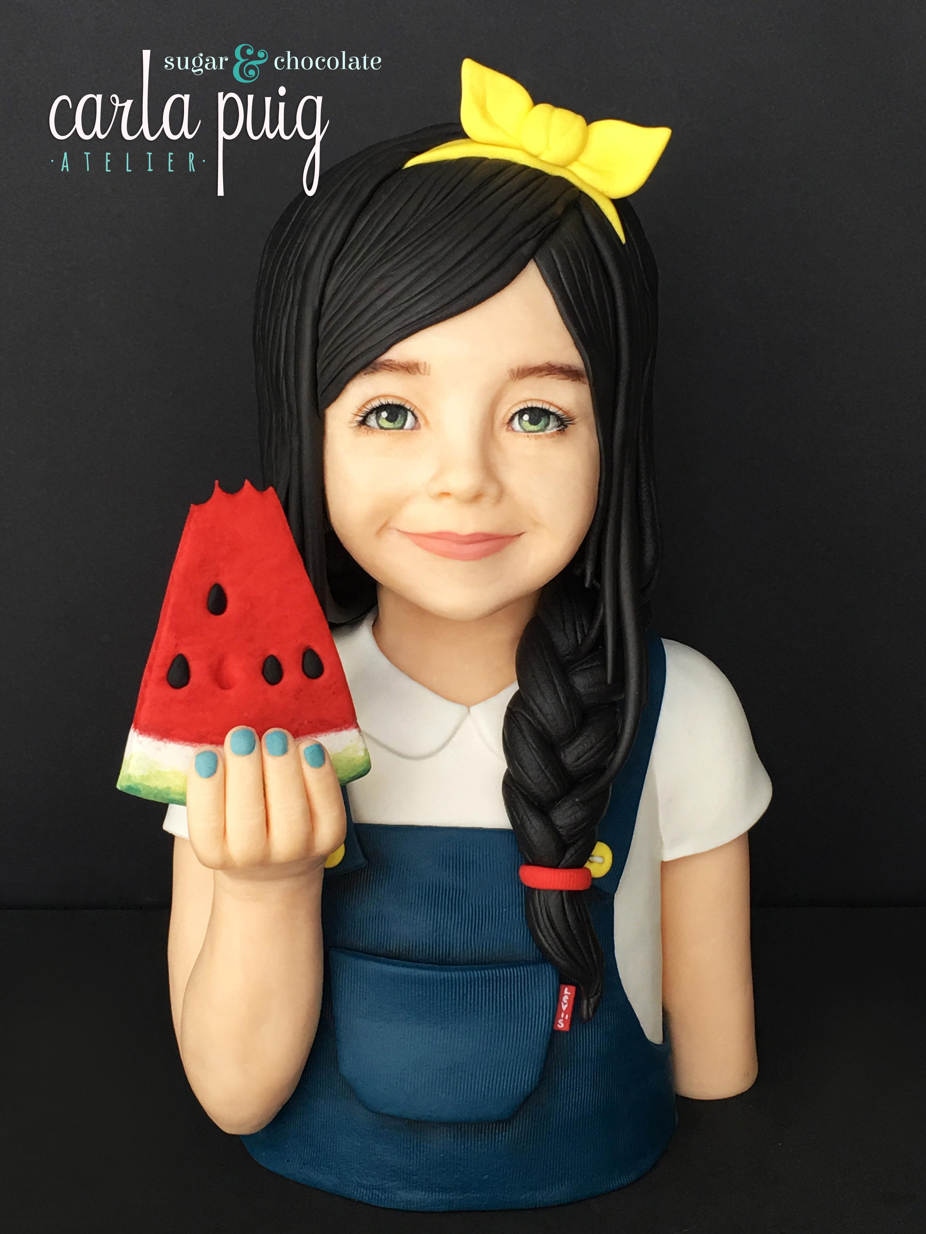 Dark haired little girl eating watermelon