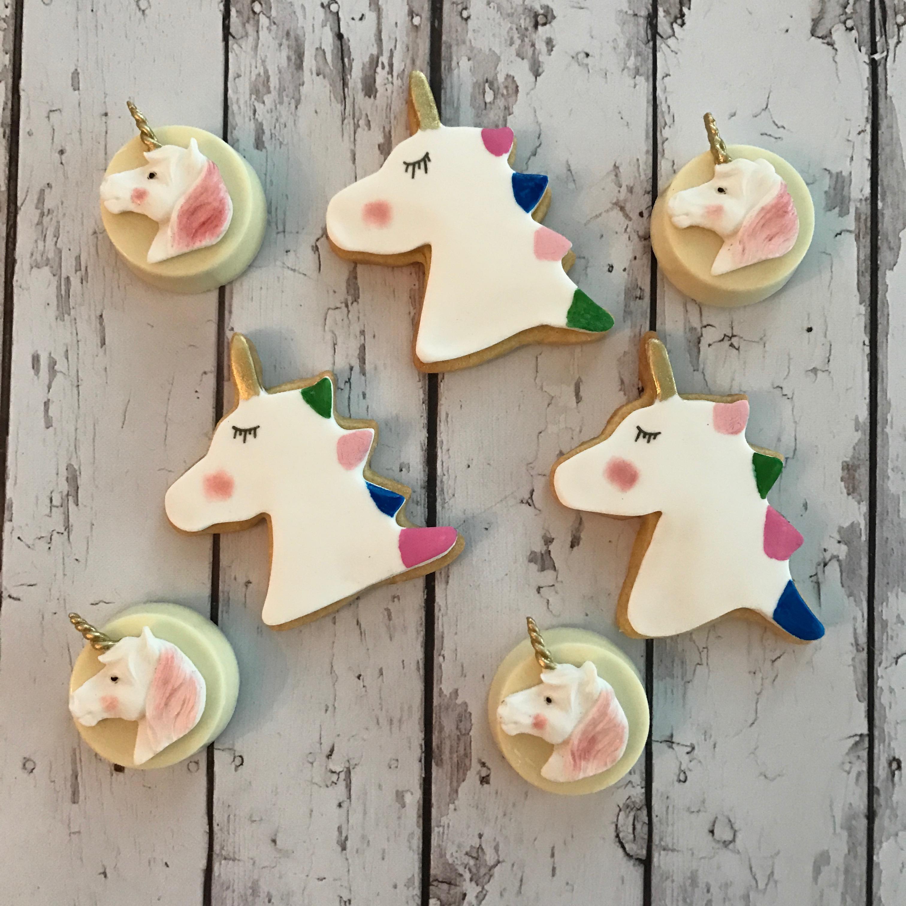 Fondant unicorn cookies and mini cakes