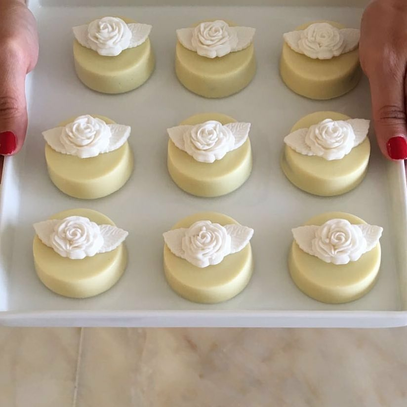 ivory petite fours with white sugar flowers