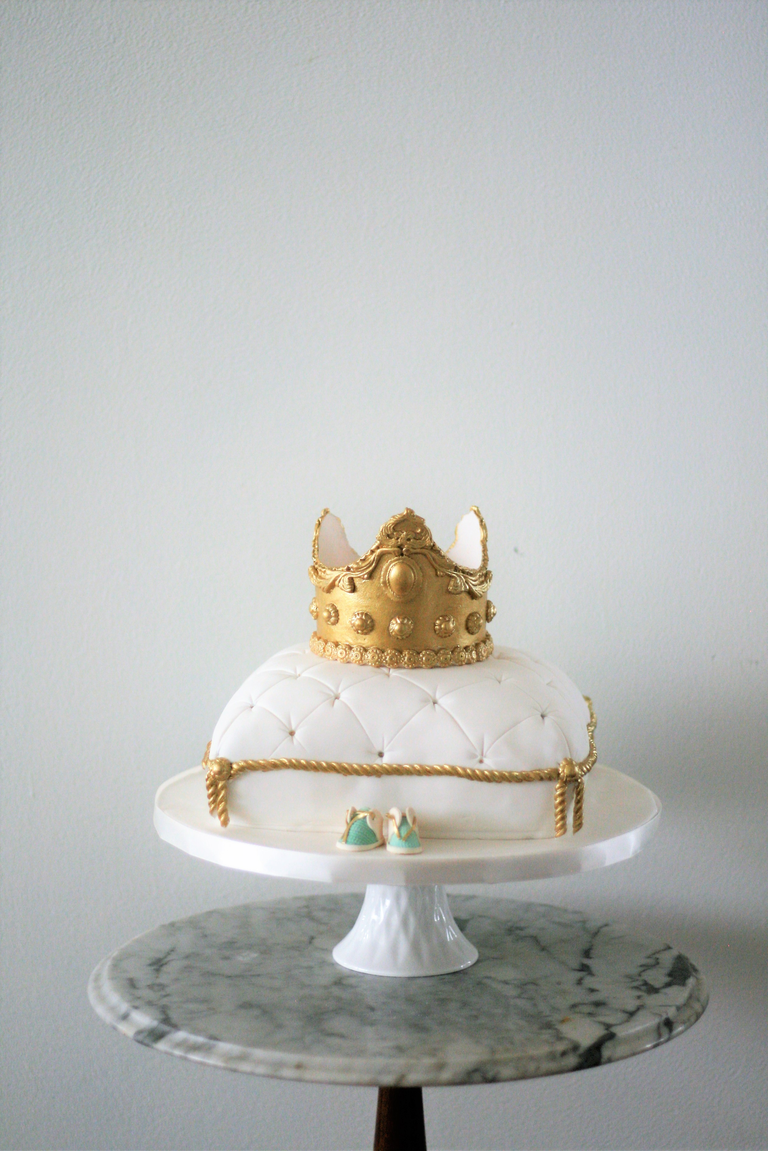 White with gold baby prince pillow cake