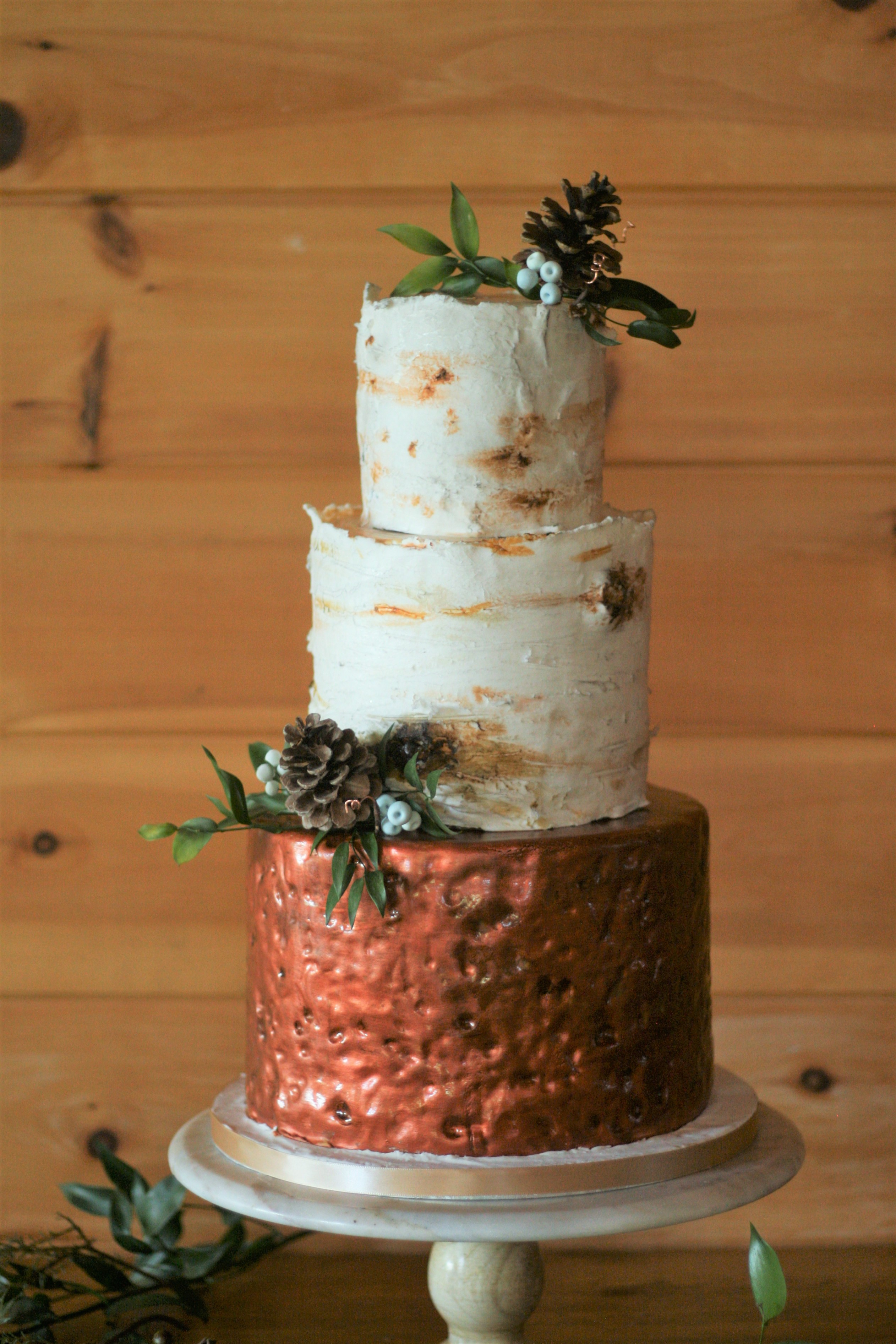 Rustic bark wedding cake with copper