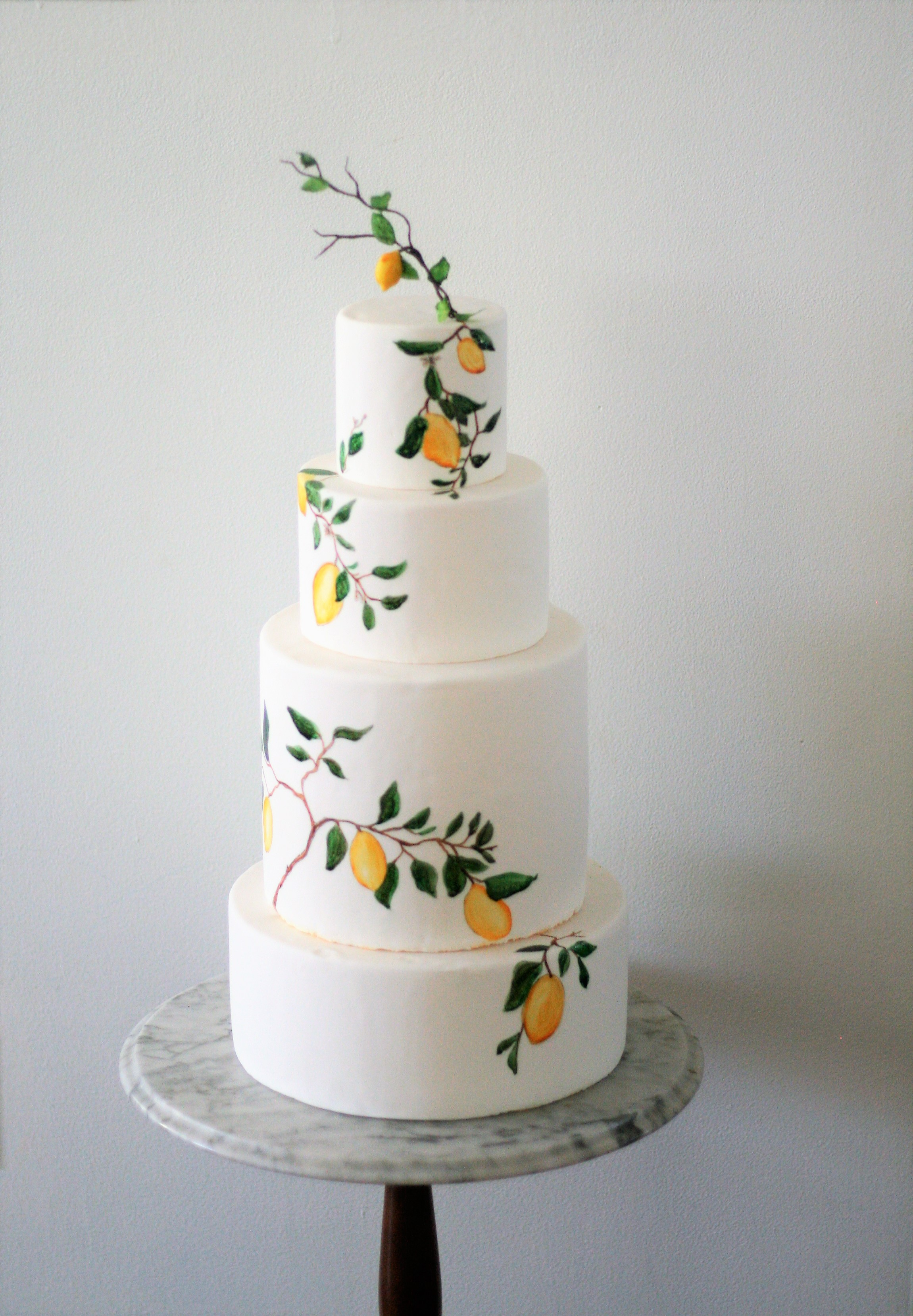 White wedding cake with hand painted lemons