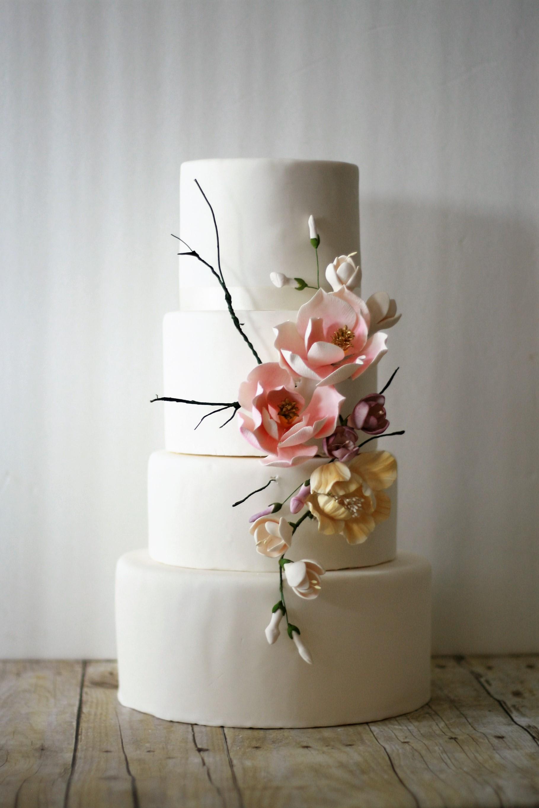 White wedding cake with sugar roses