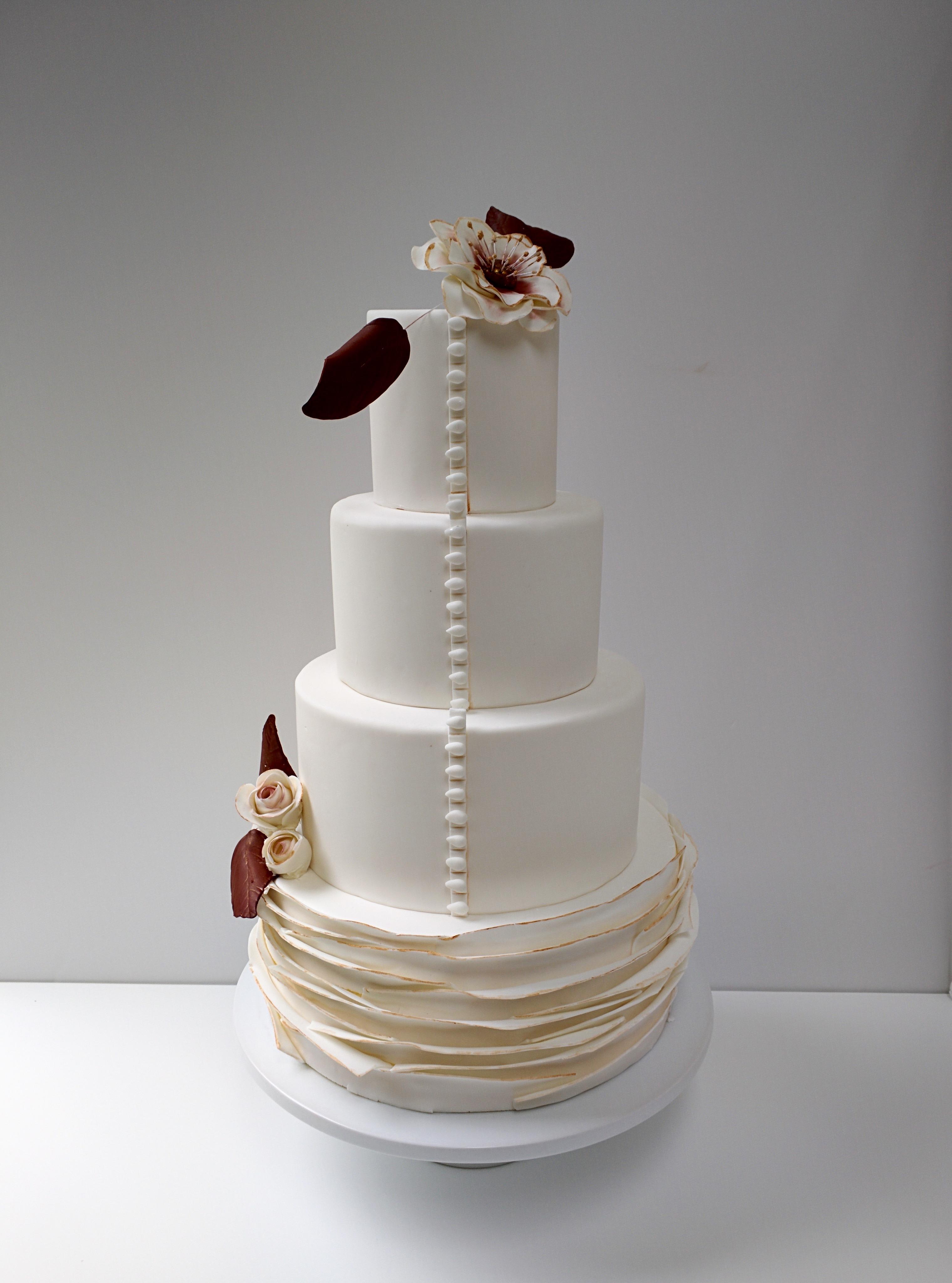White ruffle wedding with ivory