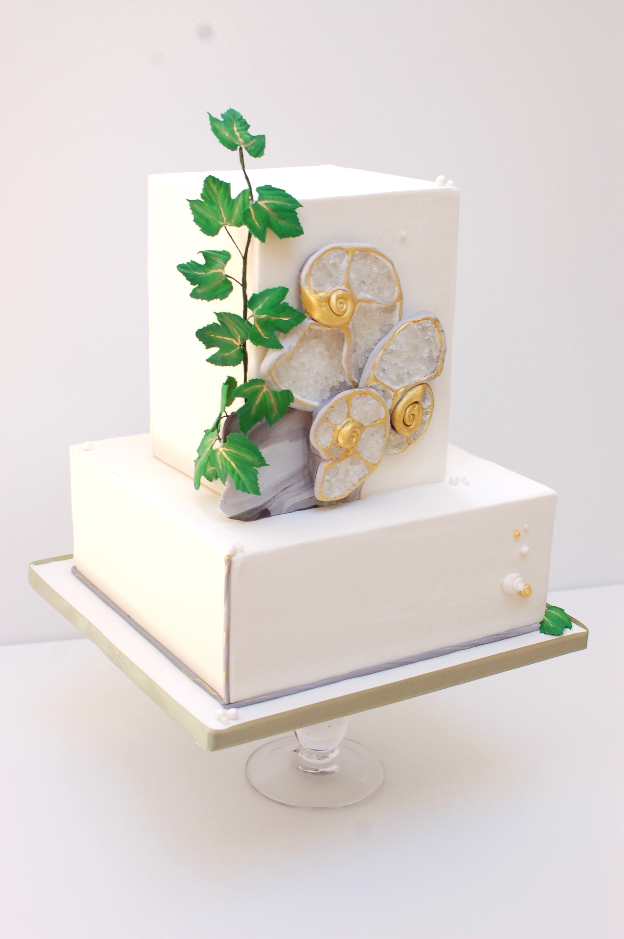 Square white wedding cake with stones