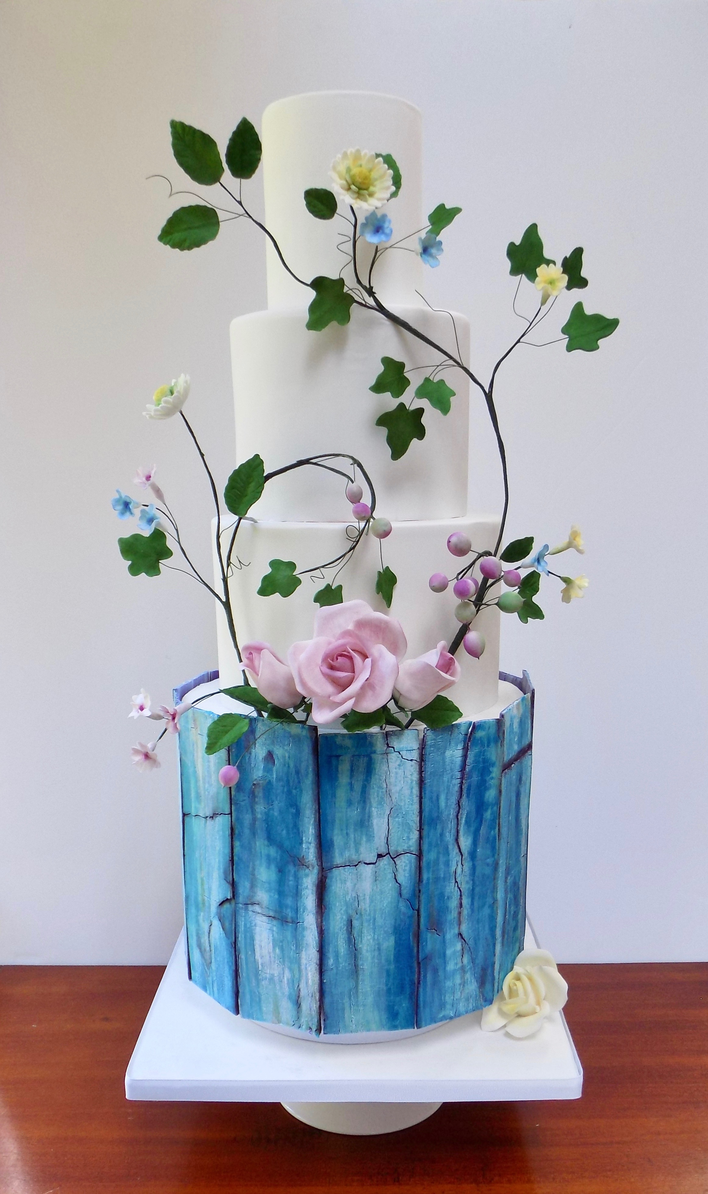 Blue bark and white rustic wedding cake