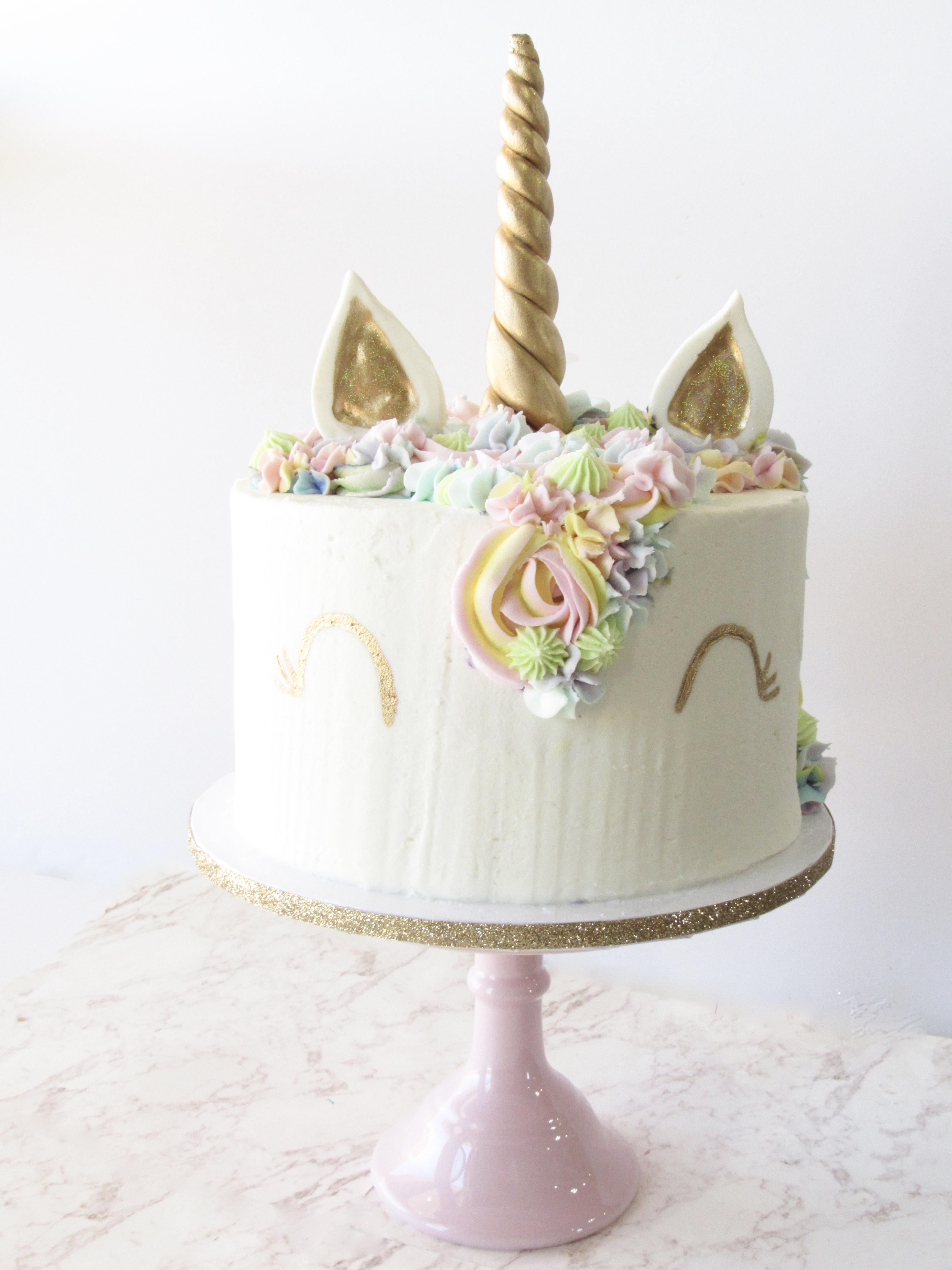 White and gold unicorn birthday and baby cake