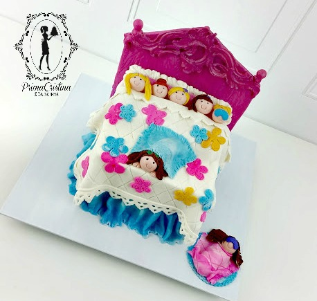 Sleepover party bed cake with figurines