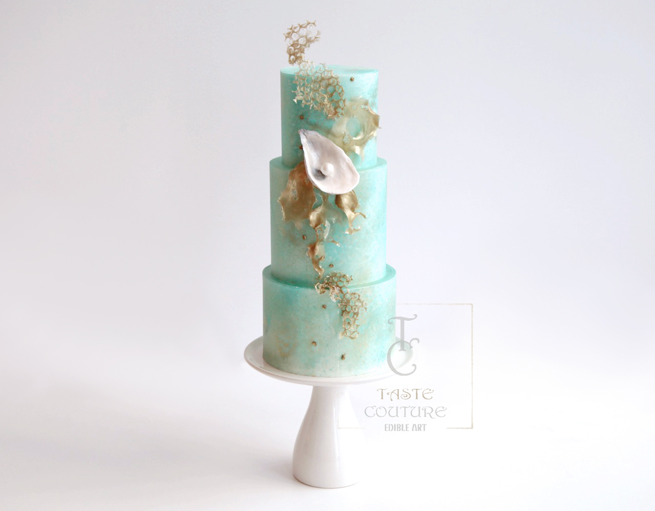 Pastel green with gold wedding cake