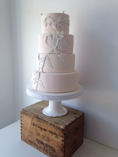All baby pink wedding cake with detailing