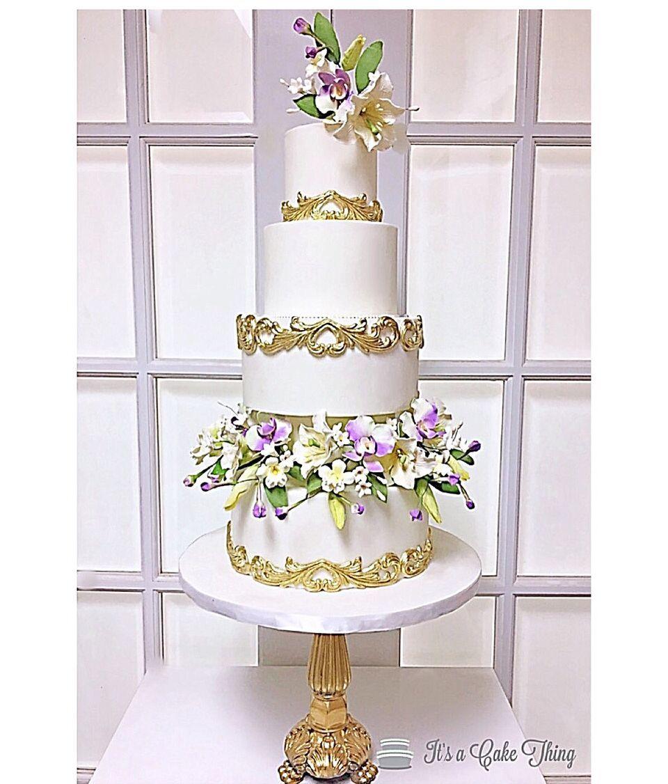 White & gold tall victorian wedding