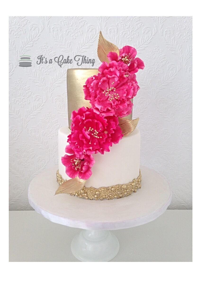 Gold Shimmer Wedding with fuchsia sugar flowers