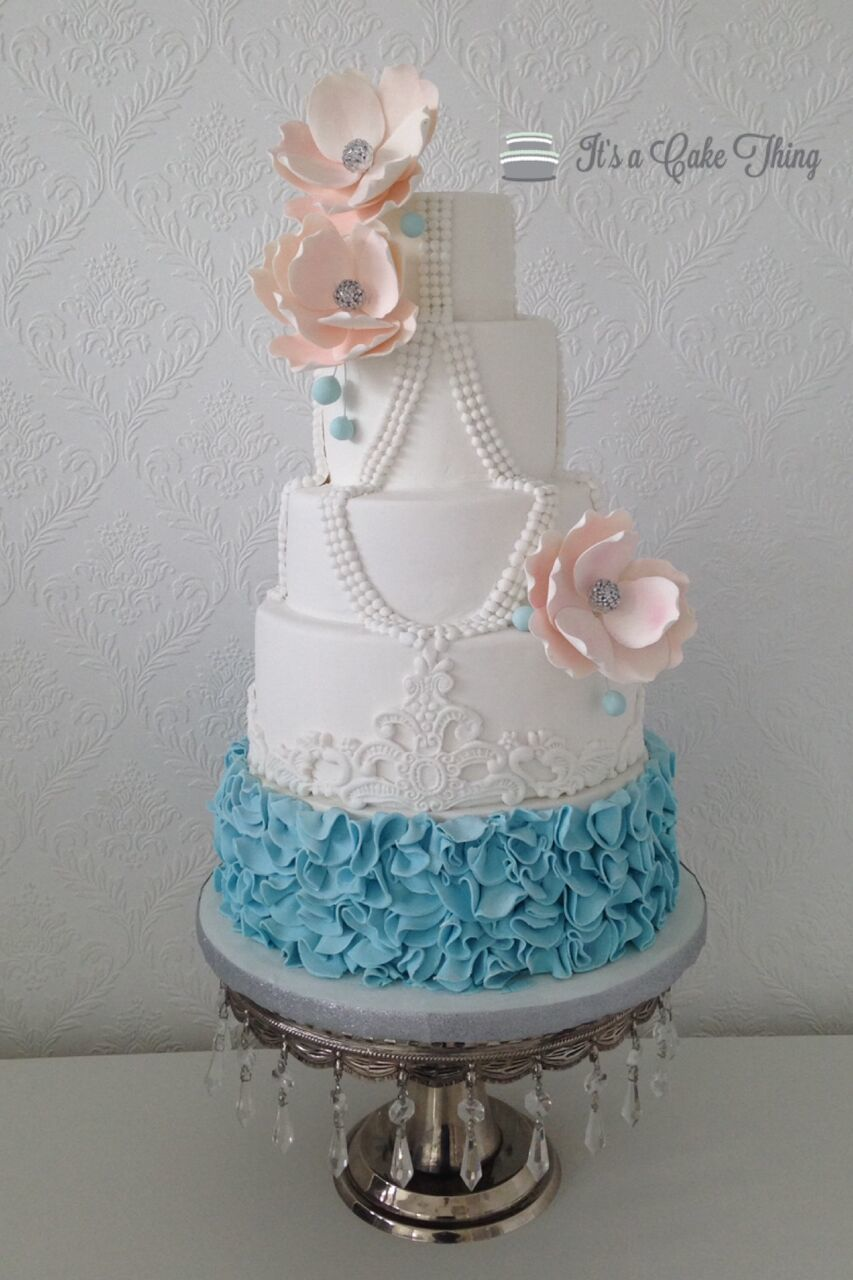 White and light blue ruffled wedding