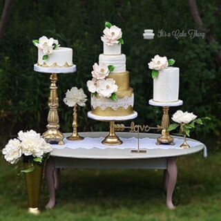 White and gold wedding dessert table