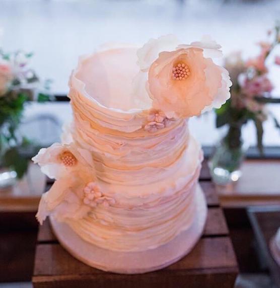 Ivory and peach ruffle wedding