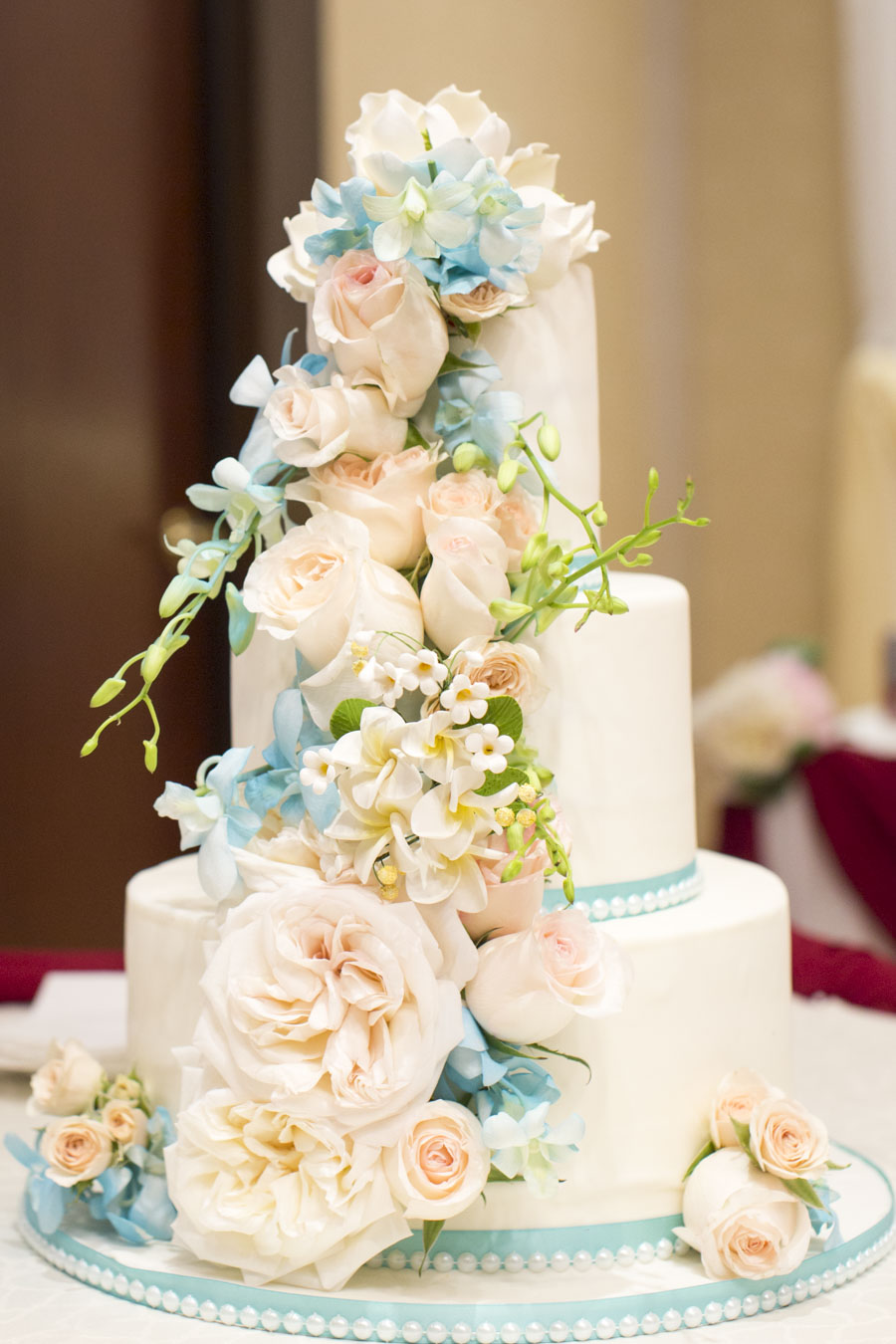 White wedding with blue and pink sugar flowers