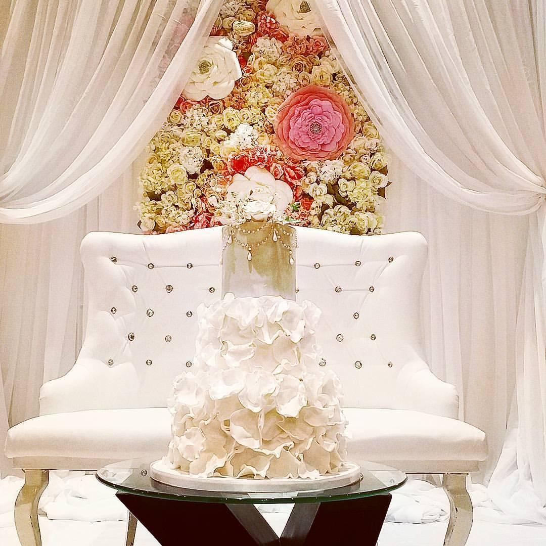 All White ruffle wedding cake with gold leaf