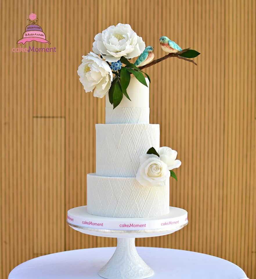 All white textured wedding cake