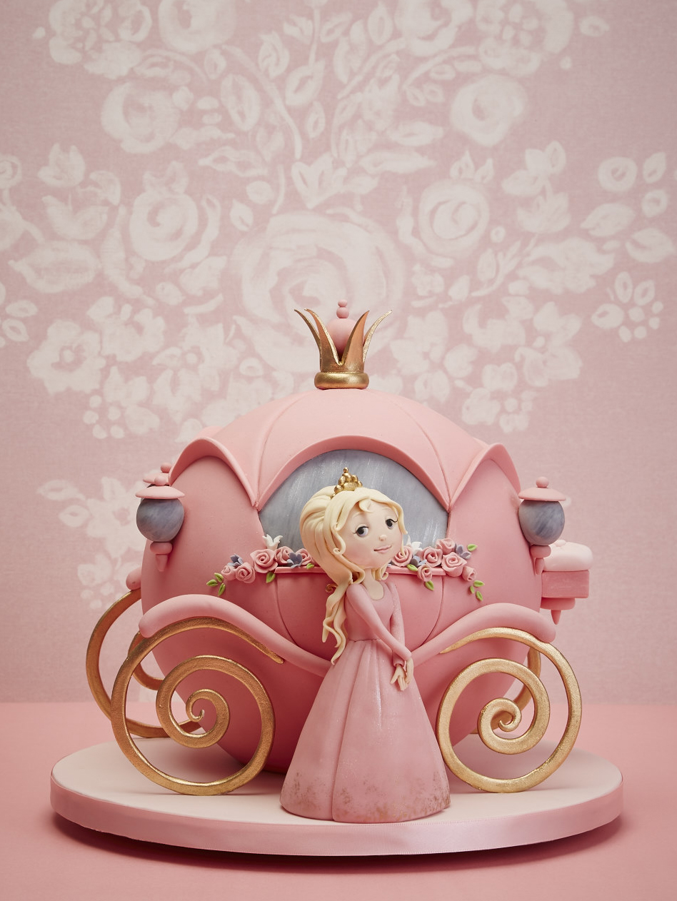 Princess figurine and pink carriage