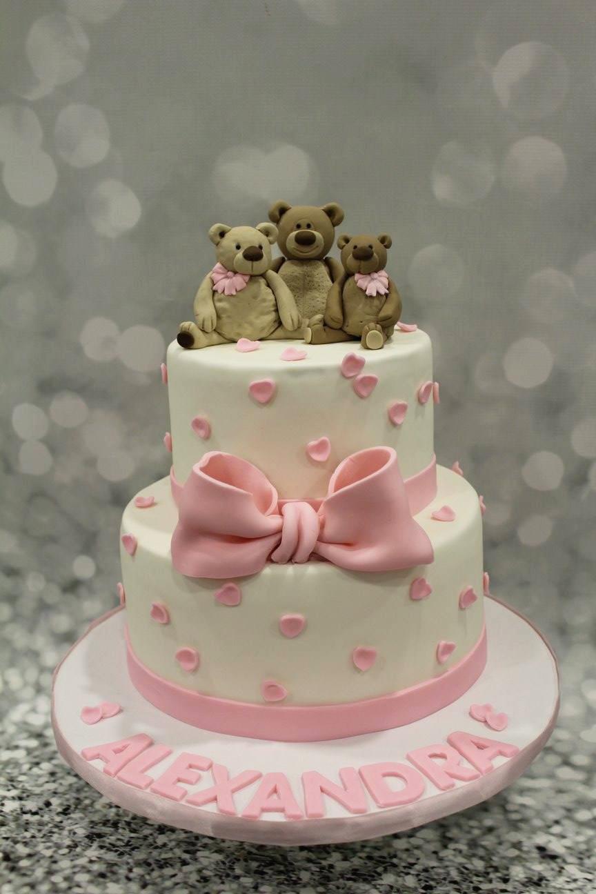 Pink and white teddy bear birthday cake