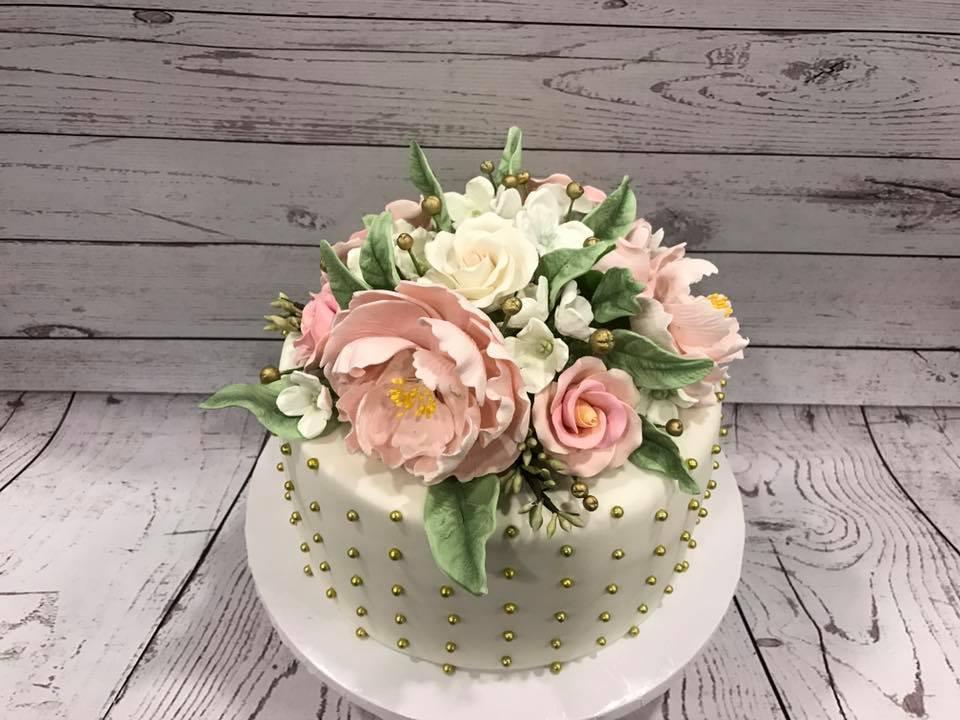 Mini white cake with sugar flower bouquet