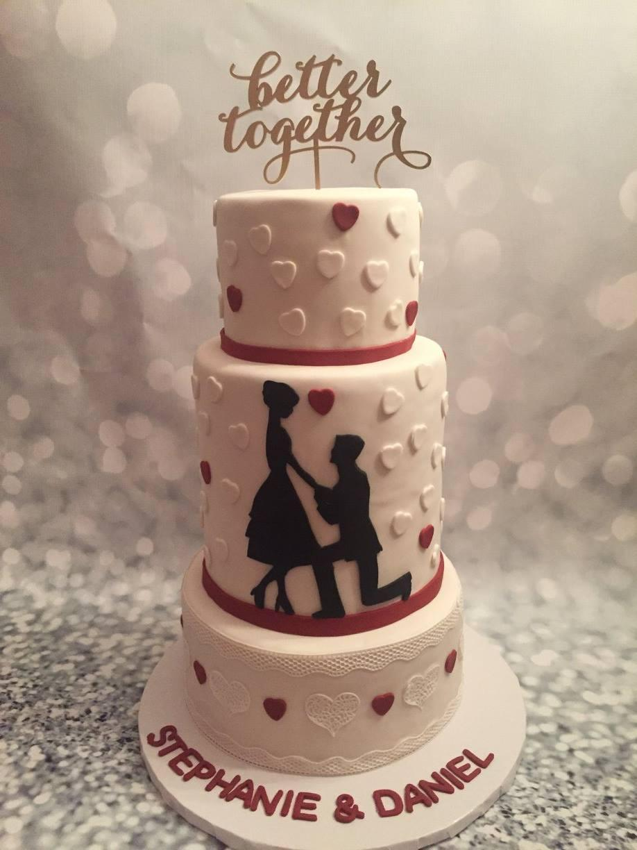 White and pink wedding cake with hearts