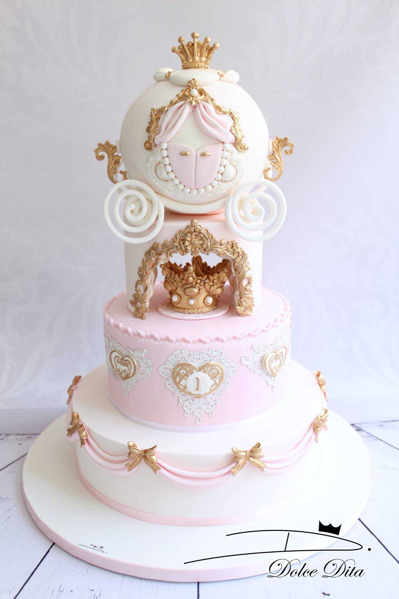 Pink white and gold princes cake
