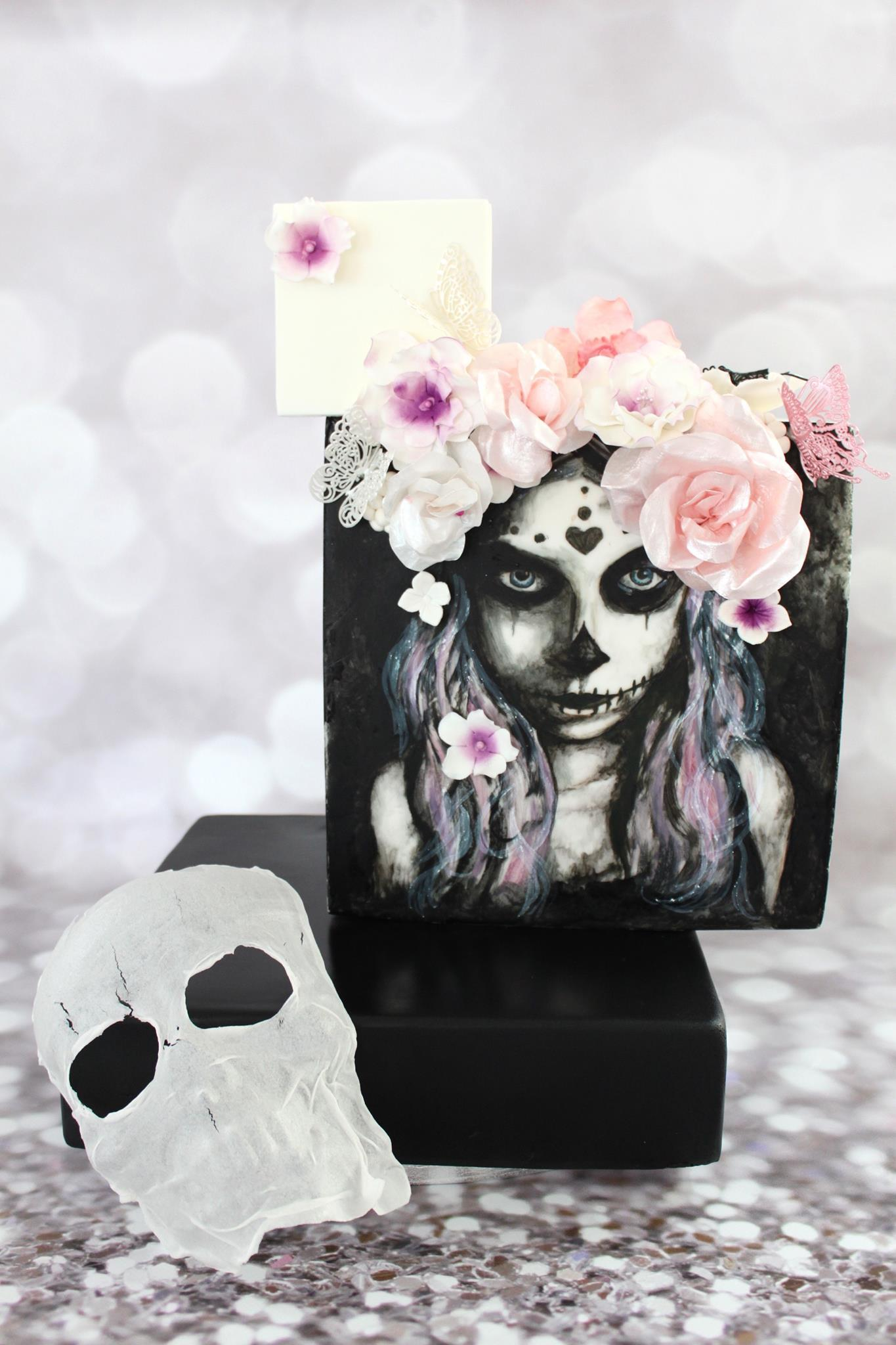 Black and white sugar skull cake with sugar flowers