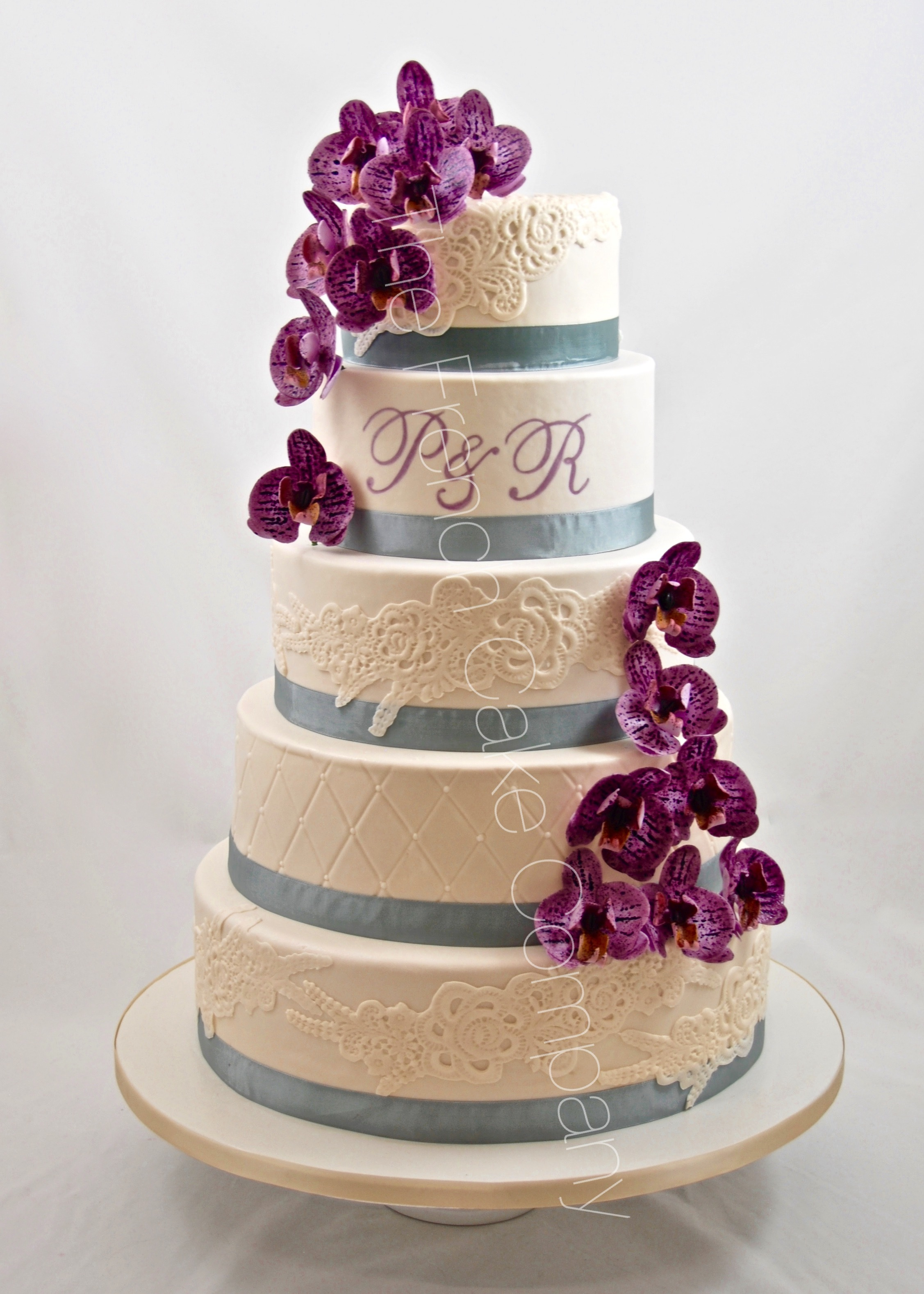 White wedding with purple sugar flowers