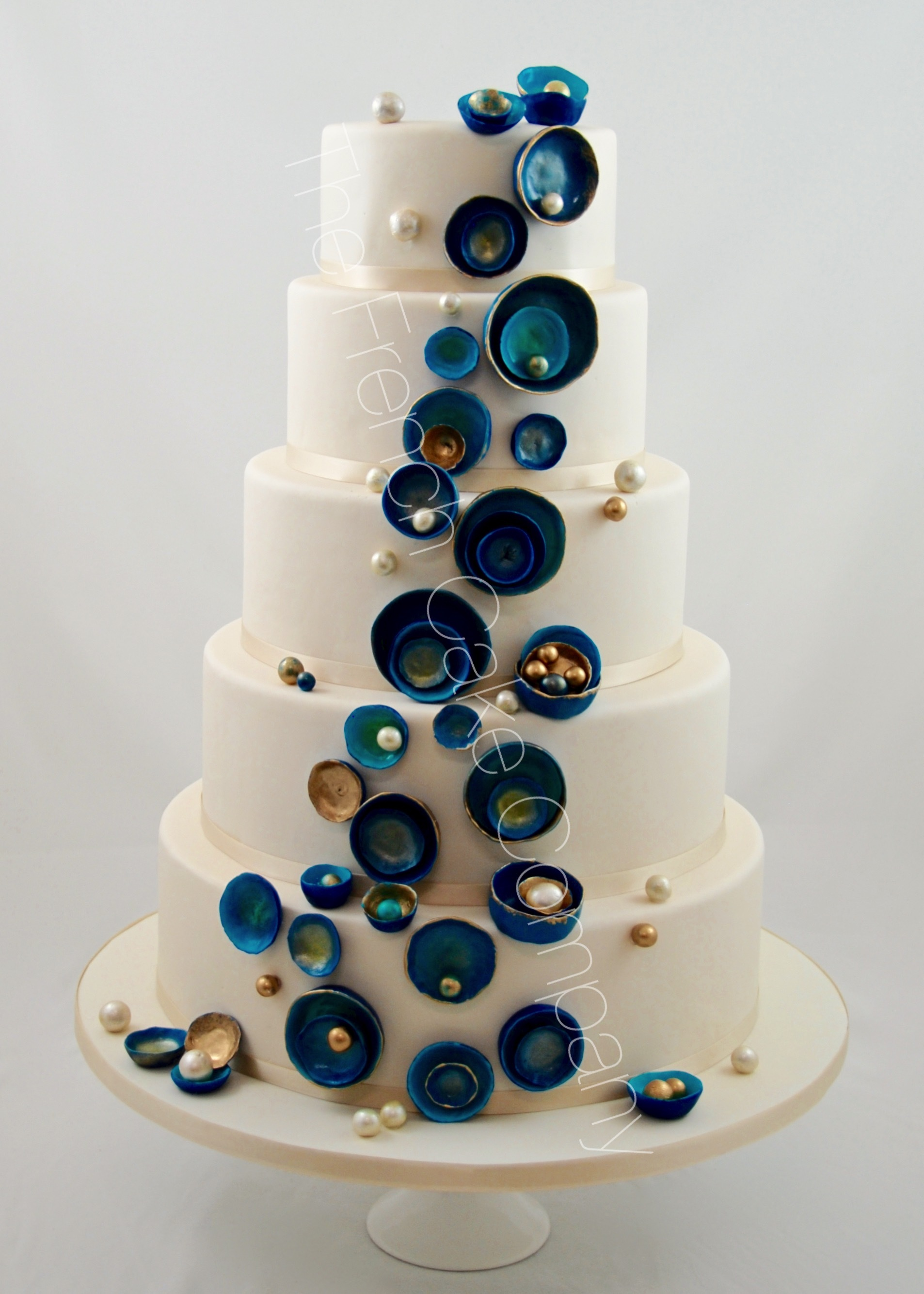 White Wedding with cascading blue buttons