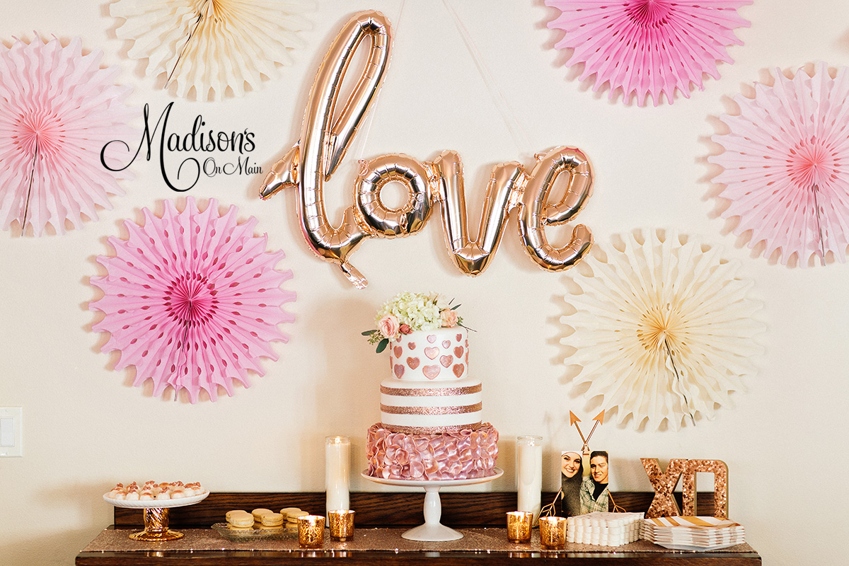Pink and gold themed wedding dessert table