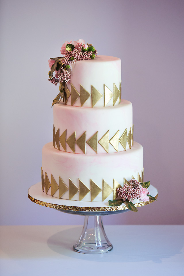 Pink and gold arrow boho themed wedding cake