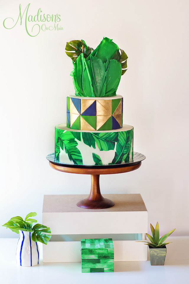 Green and gold geometric feather wedding cake