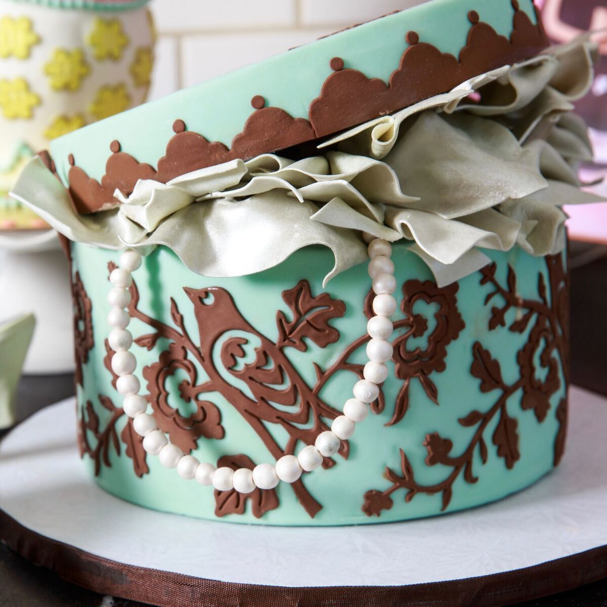 Turquoise and brown hat box cake
