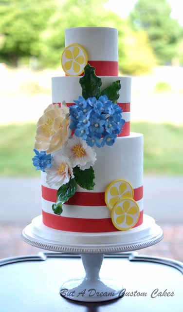 Red and white striped wedding cake with lemon details